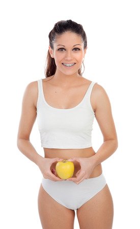 teeths: Attractive young woman in underwear with a apple isolated on a white background