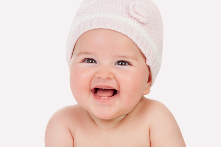Adorable baby girl with wool hat isolated on a white background photo