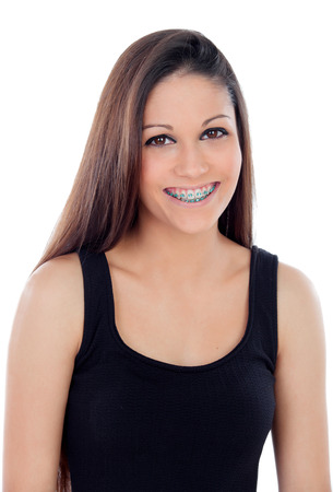 Smiling cool girl with brackets isolated on a white background Stock Photo