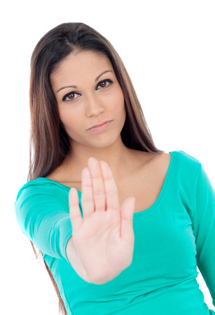 Young cool woman saying stop isolated on a white background photo
