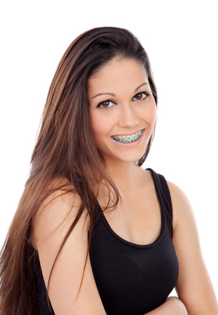 Smiling cool girl with brackets isolated on a white background Archivio Fotografico