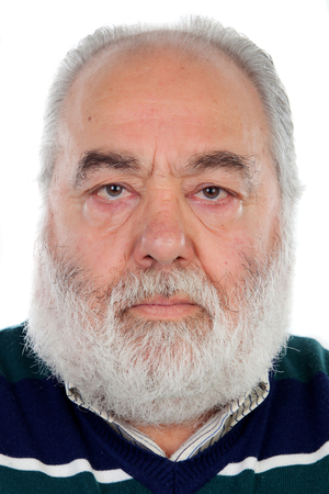 Serious senior man with white beard isolated on background Standard-Bild