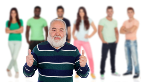 Senior man saying Ok with young people of background unfocused photo