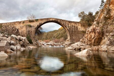 flowing river: Beautiful bridge with a clear river in mountain of Spain