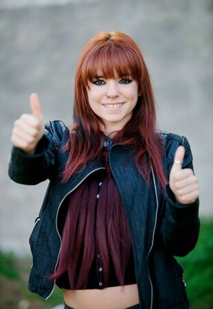 rebellious: Rebellious teenager girl with red hair smiling and saying Ok