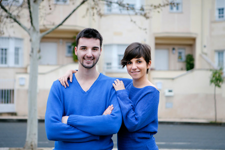 Young lovers dressed in blue excited about your new home photo
