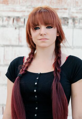 rebellious: Rebellious teenager girl with red hair smiling