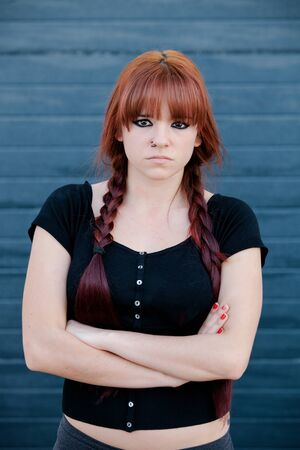 rebellious: Rebellious teenager girl with red hair very angry