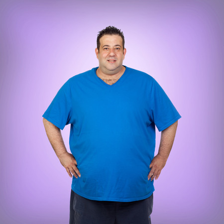 morbidity: Happy fat man with blue shirt and a purple background