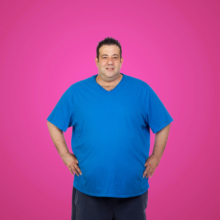 morbidity: Happy fat man with blue shirt and a pink background