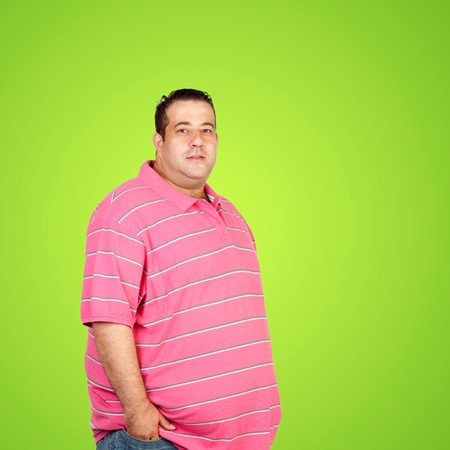 morbidity: Happy fat man with pink shirt and a green background