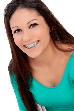 Smiling cool girl with brackets isolated on a white background Imagens