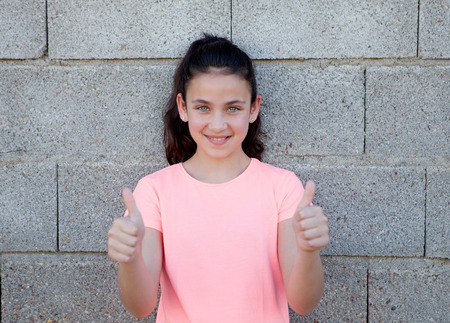 beautiful preteen girl: Portrait of a beautiful preteen girl with blue eyes saying Ok
