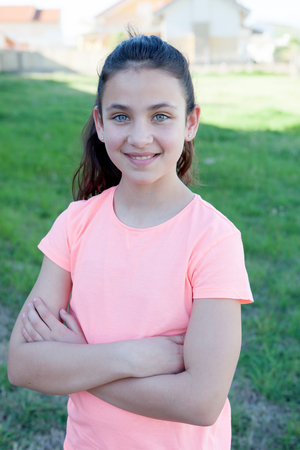 preteen model: Happy preteen girl with blue eyes smiling at outside