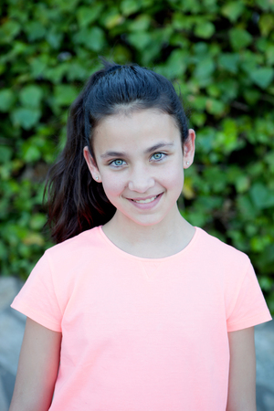 youngsters: Happy preteen girl with blue eyes smiling at outside