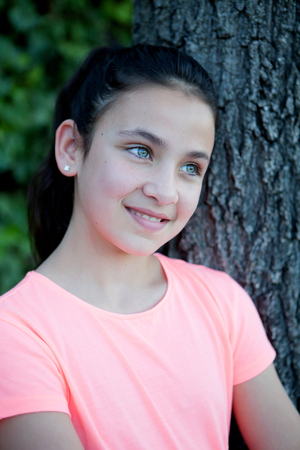 blue eyes: Happy preteen girl with blue eyes smiling at outside