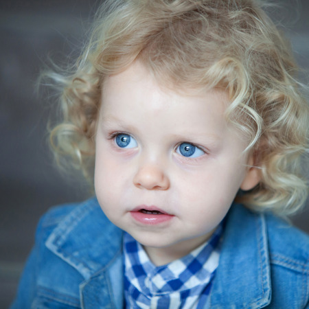 blue eyes: Nice blond baby with blue eyes and curly hair