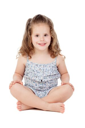 three year old: Cute little girl with three year old sitting on the floor isolated on a white background