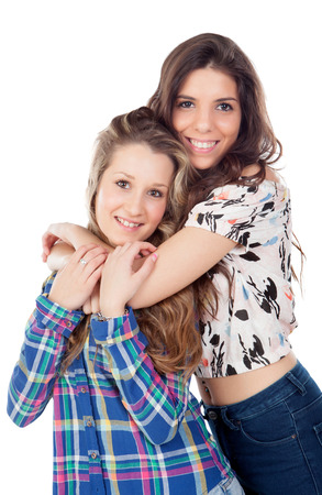 adult sisters: The best friends. Two pretty women isolated on a white background