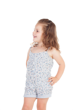 white girl: Cute little girl with three year old looking at side on a white background Stock Photo