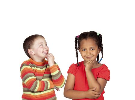 elementary age: Couple of pensive children isolated on a white background