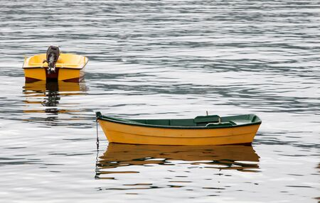 yellow boats: Couple of yellow boats floating on a calm sea