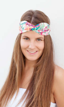 flowered: Cool trendy girl with a flowered hair scarf smiling