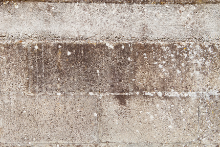 damaged cement: Grey wall of cement blocks damaged by the passage of time