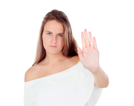 requiring: Young blonde woman requiring stop with her hand isolated on a white background
