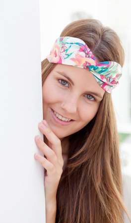 trendy girl: Cool trendy girl with a flowered hair scarf smiling
