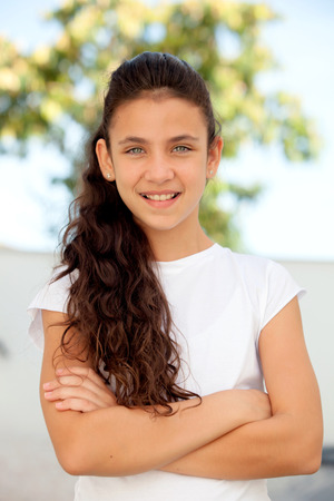 crossing arms: Teenager girl with blue eyes crossing arms outdoor