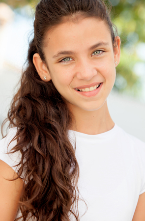 blue eyes: Teenager girl with blue eyes smiling outdoor