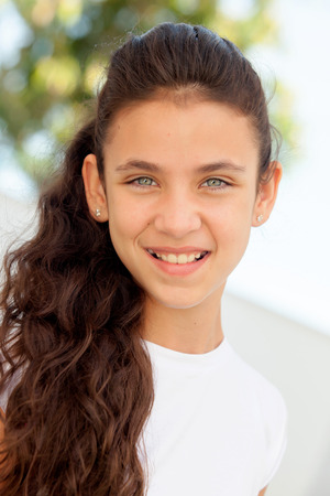 hispanic girl: Teenager girl with blue eyes smiling outdoor