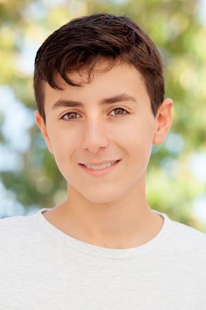 thirteen: Casual Thirteen year old teenage boy smiling outside Stock Photo