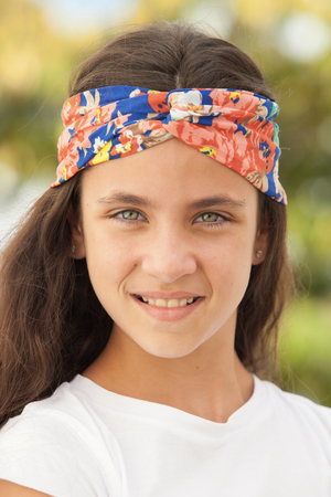 flowered: Pretty teenager girl with a flowered headband outdoor