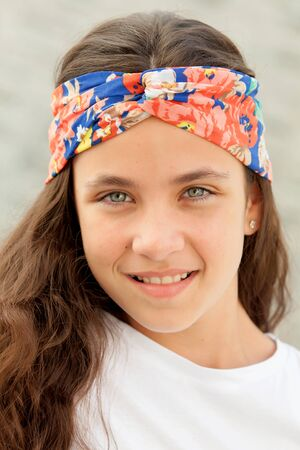 flowered: Pretty teenager girl with a flowered headband smiling Stock Photo