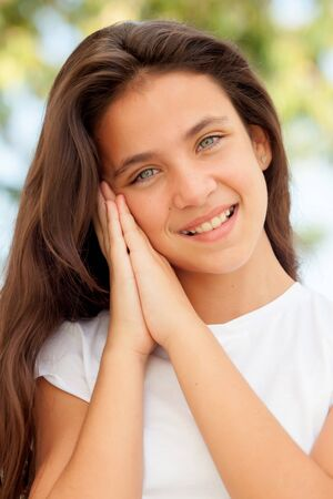 pretty woman face: Pretty young preteen making the symbol of sleep outdoors Stock Photo