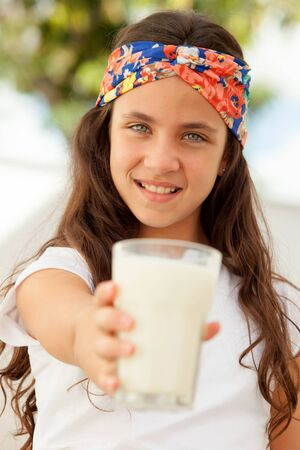 preteen  pure: Teenager girl with blue eyes and a milk glass Stock Photo