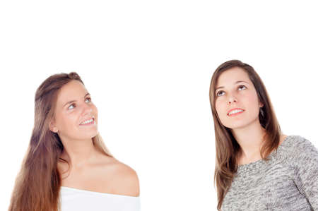looking up: Two cool girl looking up isolated on a white background