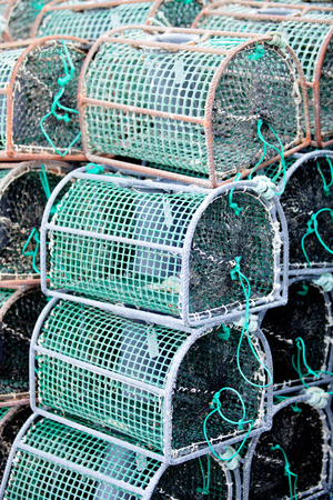 commercial fishing net: Many octopus traps stacked at the port
