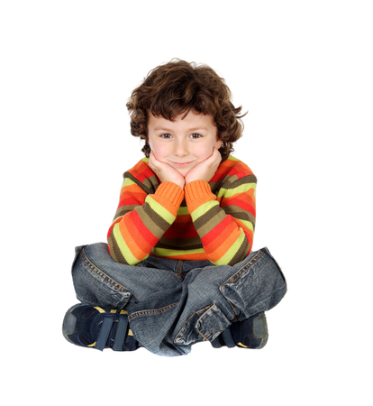 sitt: Nice boy with seven years old sitting on the white floor thinking
