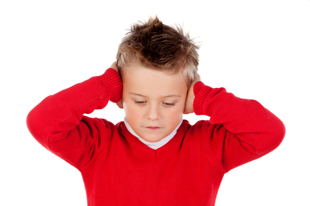 deafening: Little kid covering the ears isolated on a white background