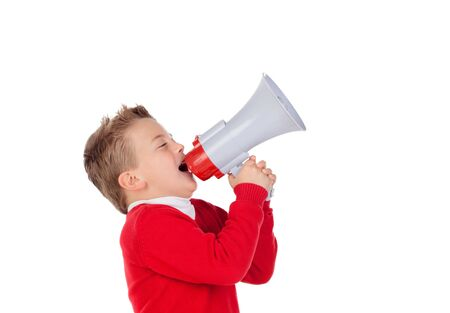 beautiful boy: Small boy shouting through a megaphone isolated on white background