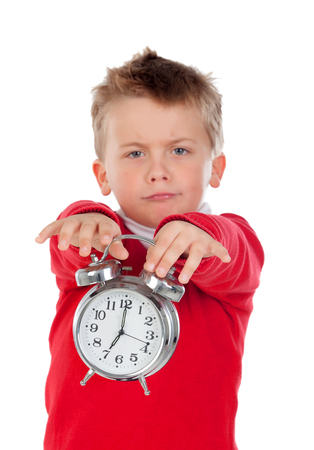bothered: Angry little boy holding a clock isolated on white background Stock Photo