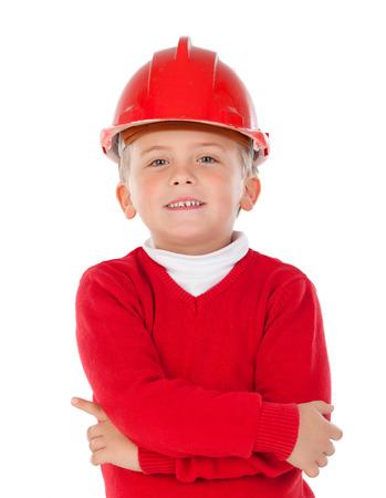 casco rojo: Ni�o lindo con el casco rojo aislado en un fondo blanco Foto de archivo