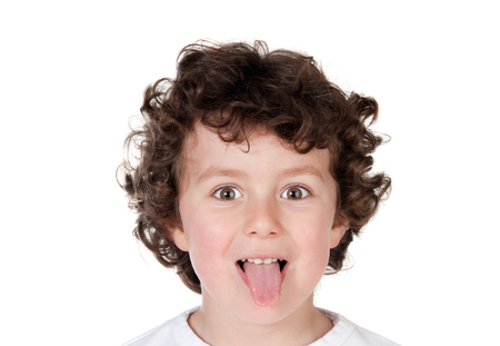 bad manners: Kid sticking out tongue isolated on a white background