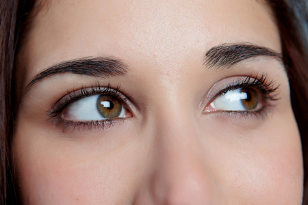 ady: Young girl with brown eyes thinking while looking to the side