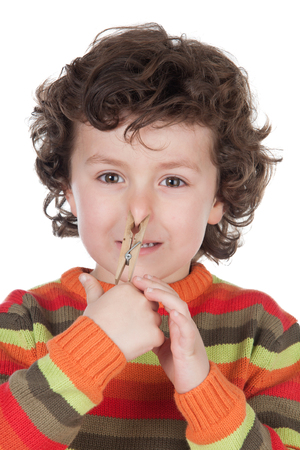 one child: Funny child covering the nose with a pin isolated on a white background Stock Photo
