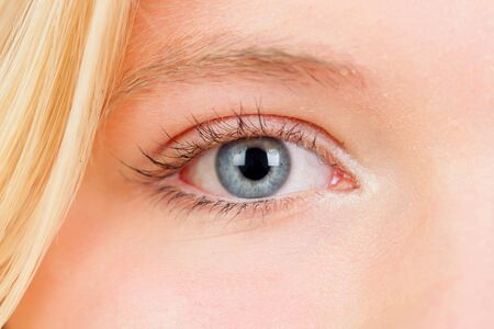 closely: Russian-born woman with blue eyes and blond hair closely