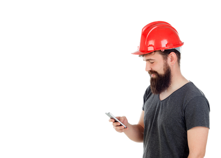 casco rojo: Young men with hipster look and red helmet looking the mobile isolated on white background